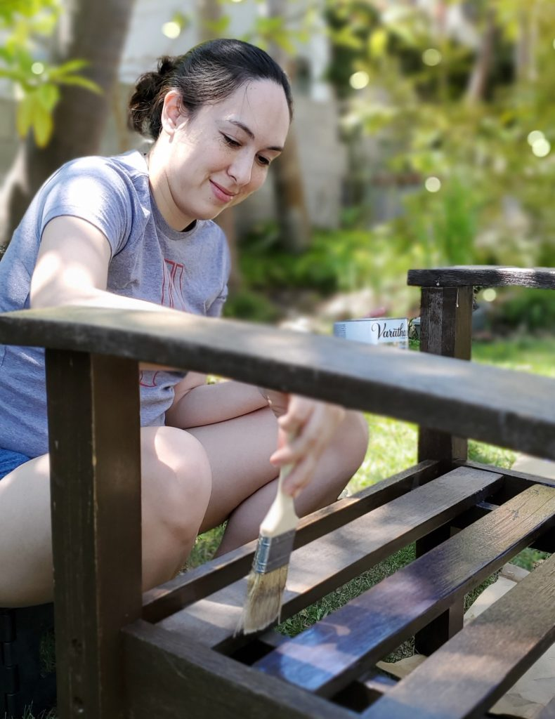 me, makeupless, varnishing some outdoor furniture